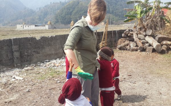 Student with young students Construction Community Service Learning Tour Nepal