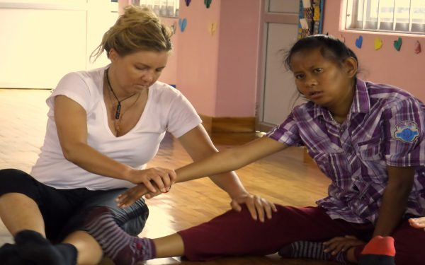 Helping with physio Community Service Learning Tour Nepal