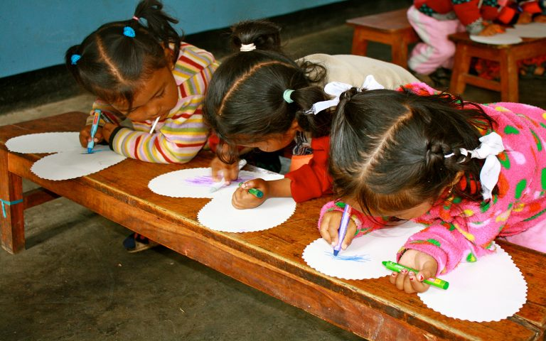 Young girls drawing Consutruction Community Service Learning Tour Nepal