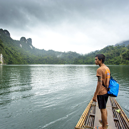 Student on a lake in Thailand on a service tour