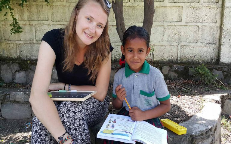 Teaching from textbook Community Service Learning Tour India