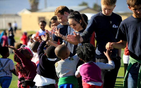 Clapping Hands Students with local students after games Service Learning Tour Cape Town South Africa