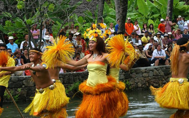 Polynesian dancers dancing for a crowd