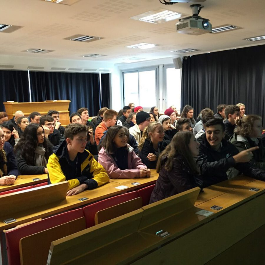 Students listening in lecture theatre
