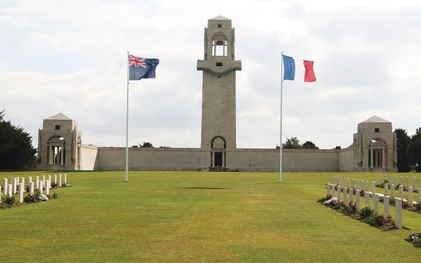 French and Australian flags in memorial grounds